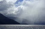 Rain falling in sheets across Lake Te Anau